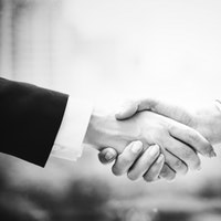 Photo of two shaking hands for liability insurance