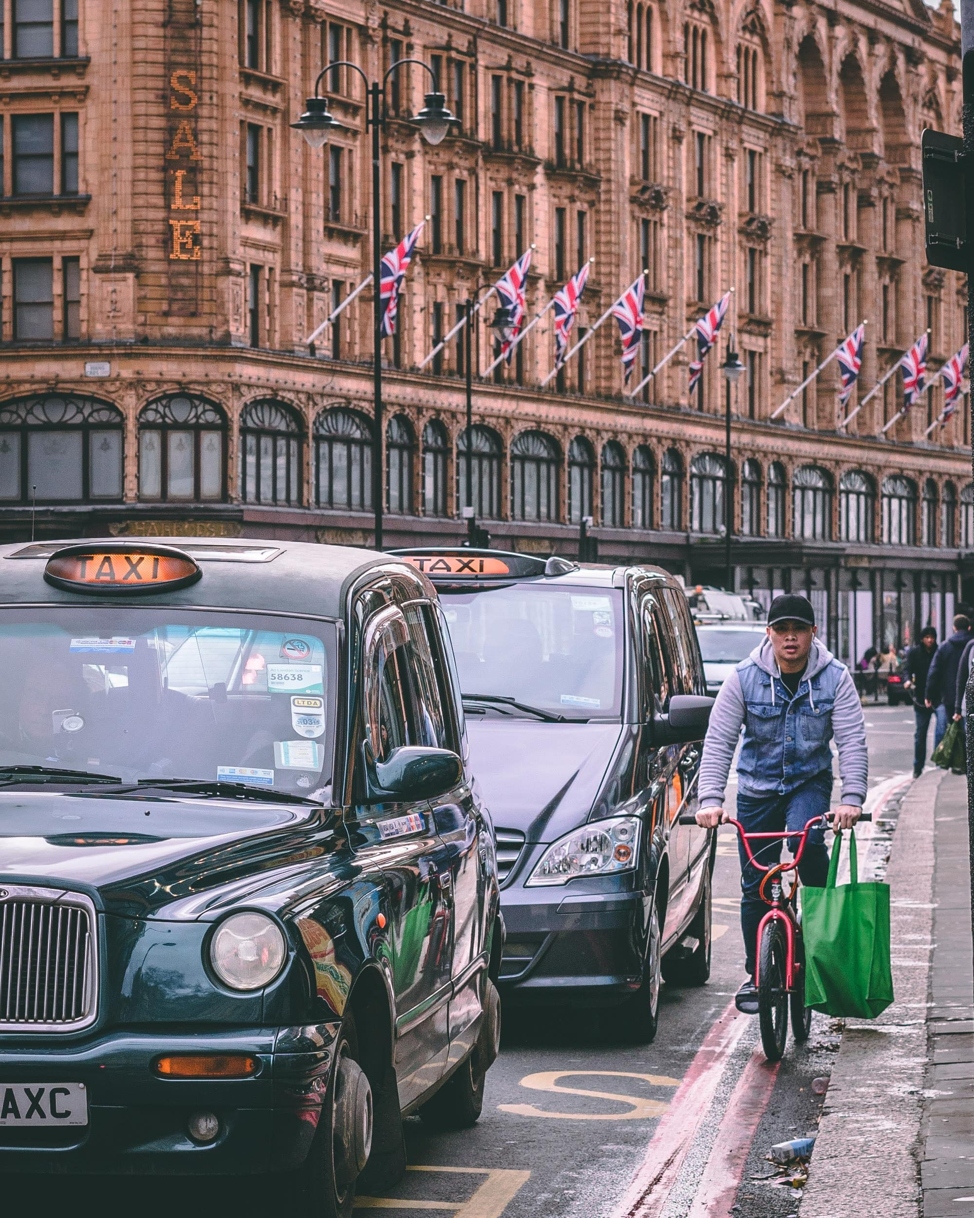 Photo of cabs and a bicycle rider